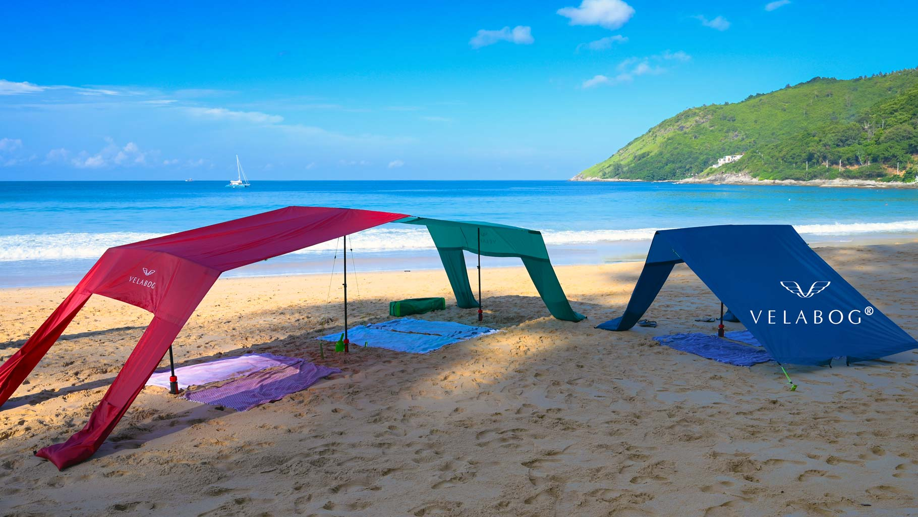 Three Velabog sun sails «Breeze» on the windless beach. Sun sail, beach umbrella and beach tent in one. Combination with the help of extension set. Provides a lot of shadow for the whole family and friends.